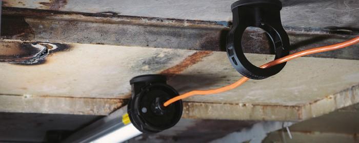 SLAM Hornet installed to steel ceiling with SLAM magnets
