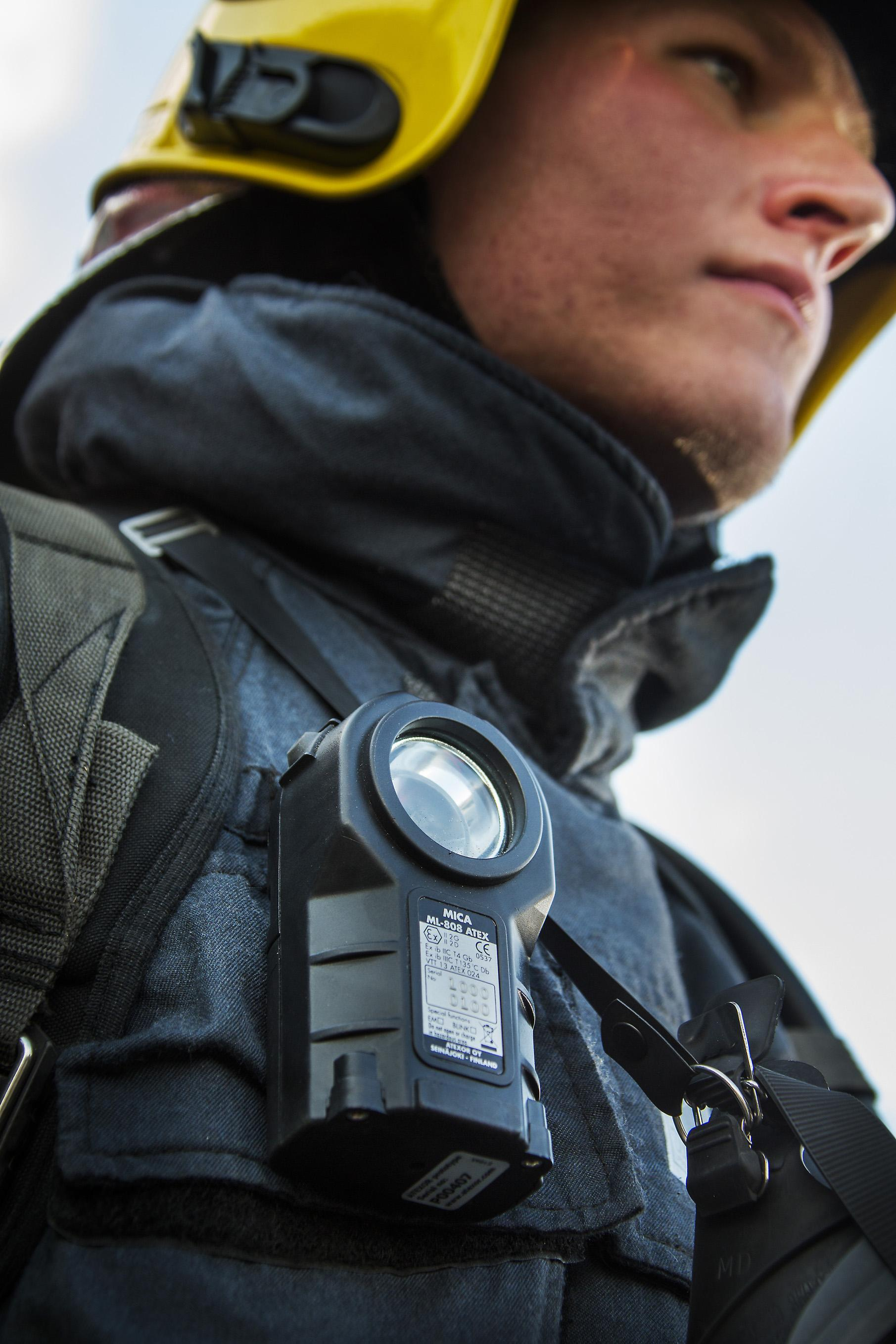 MICA ML-808 ATEX handlamp installed to firefighters harness.