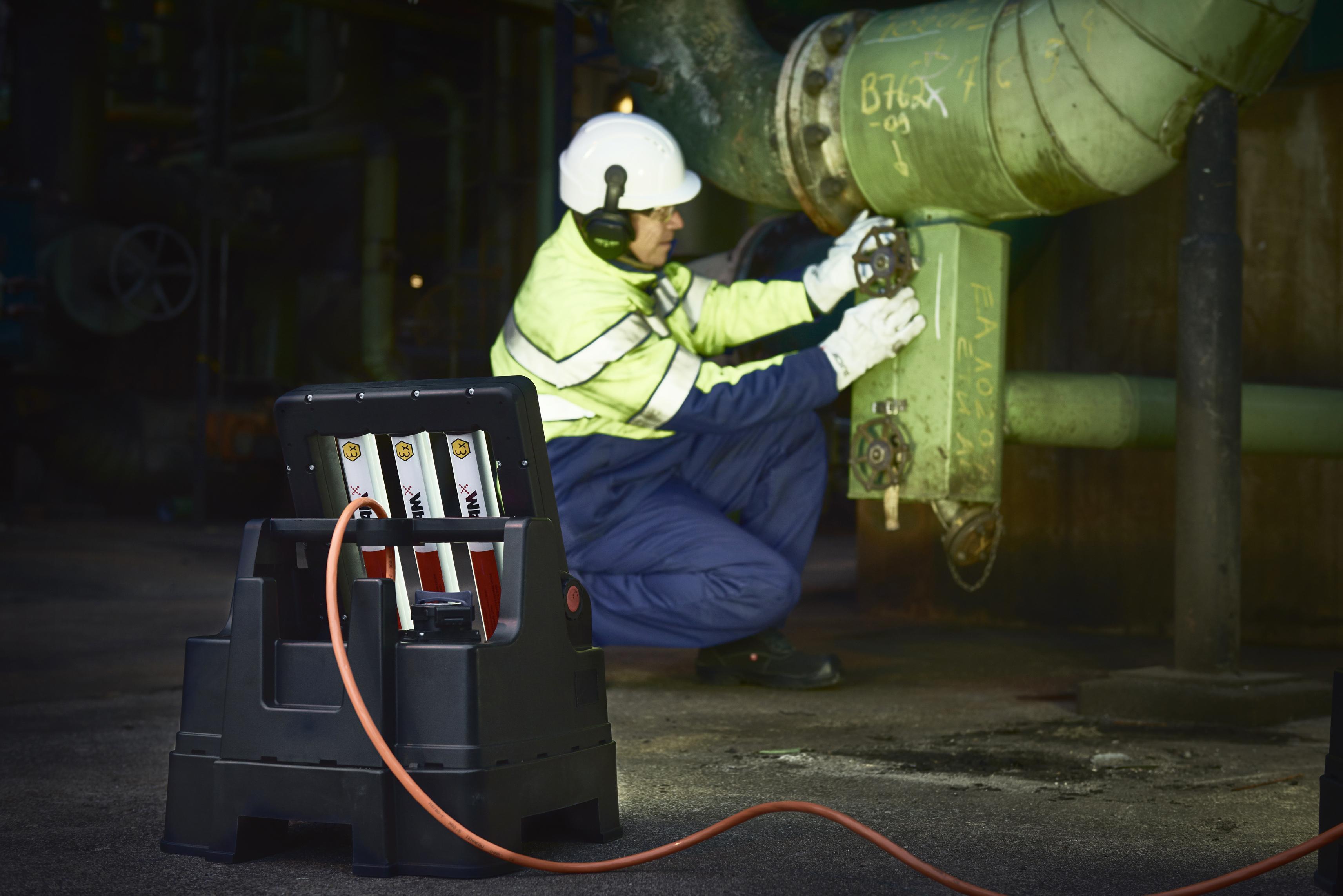 Portable SLAM LED floodlight in oil refinery.