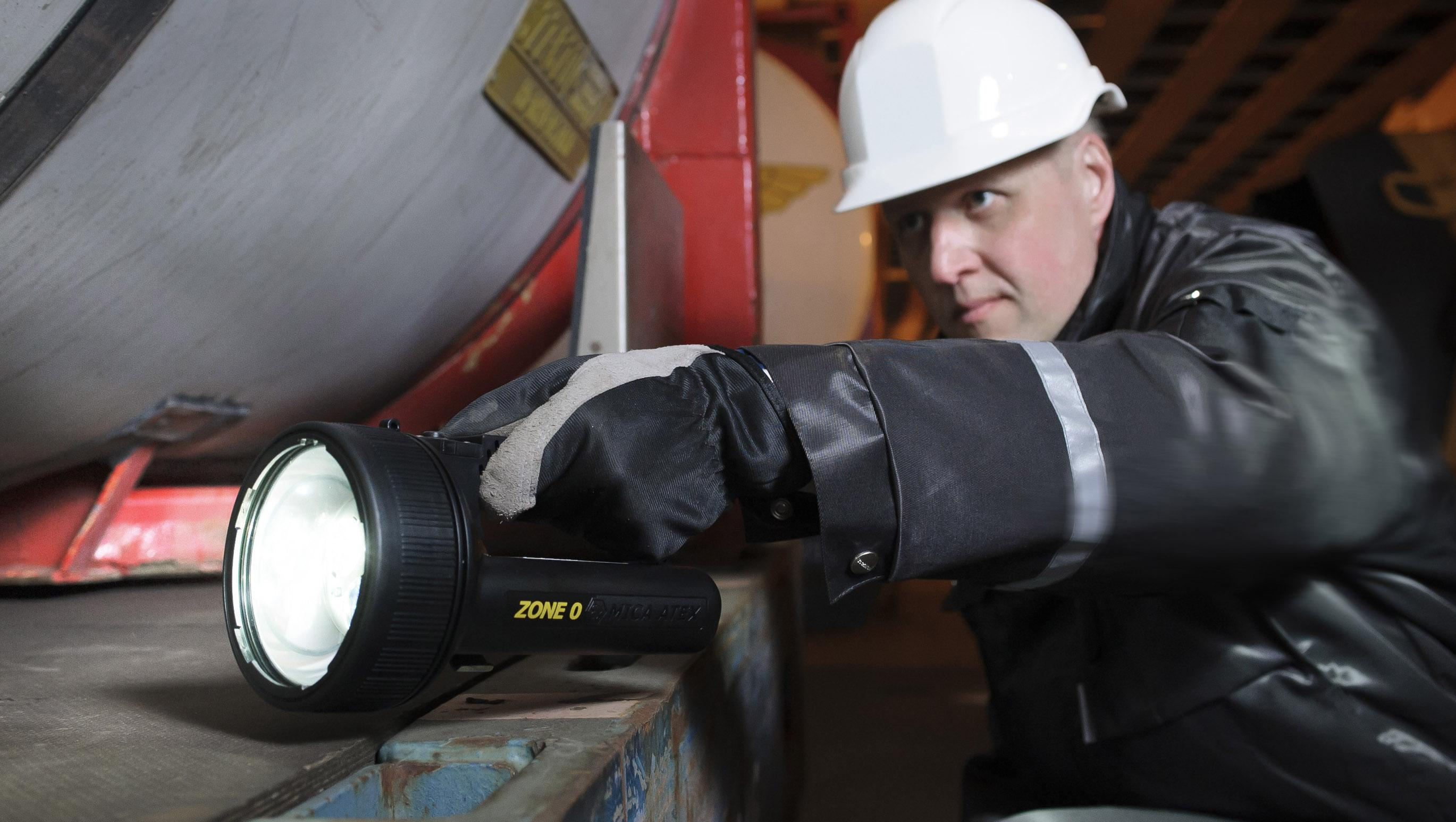 Zone 0 certified MICA IL-800 ATEX hand lamp used with fuel tank check.